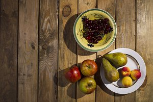 Fruits plates standing on a wooden b