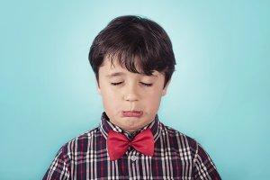 sad boy with bow tie