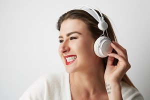 Smiling beautiful young woman listen