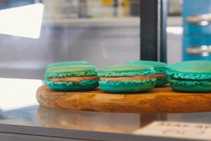 Blue pretty macaroons behind the