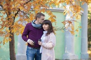 Loving couple under the autumn tree
