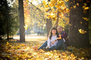 Loving couple sit on the leaves