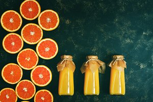 Orange juice in bottles and orange