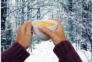 hands with winter coffee