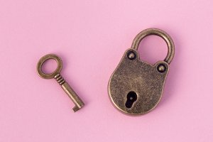 bronze key and padlock