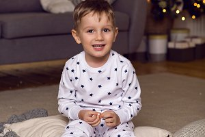 baby boy in pajamas sitting on