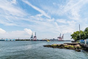 Industrial harbor with cranes on the