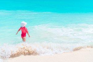 Adorable little girl at beach having