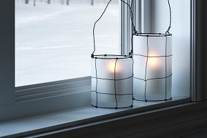 Cozy lanterns on a windowsill