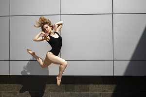 A beautiful girl dancing in the city