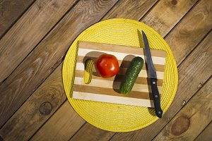 Vegetables lying on a cutting board.