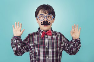Funny boy with fake mustache and tie