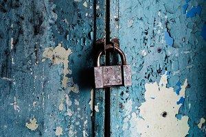 big granary lock on old blue door