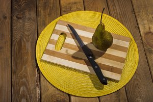 Pear on a chopping board.