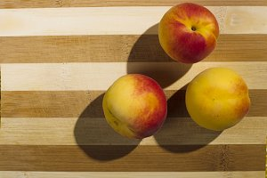 Apricots on a wooden background.