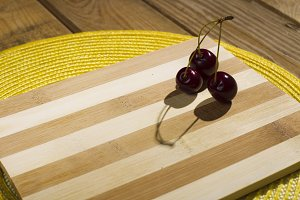 Berries cherry on wooden background.