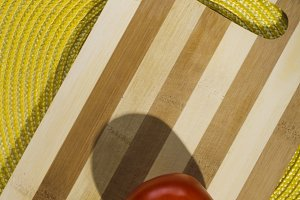 Tomatoes on the wooden background.