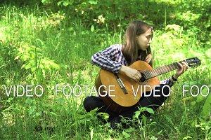 Girl playing the guitar.