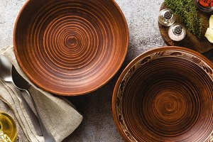 dishes of red clay on a stone table