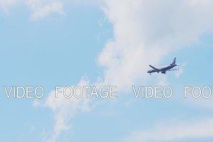 Flying plane in blue sky.