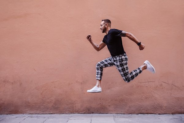 People Images: OSORIOartist - Young boy jumping on the street