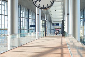 Clock at modern airport hall