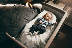 Top view of a baby sleeping in a bed