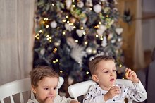 two brothers in pajamas sitting at