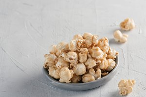 popcorn on gray concrete background
