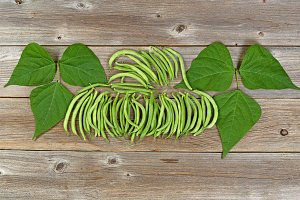 Organized green beans on wood