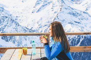 Woman in a cafe at a ski resort.