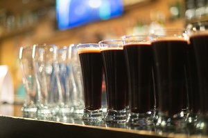 Beer glasses with dark beer are on t