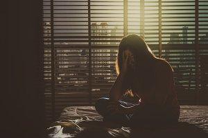 depressed Women sitting head in hand