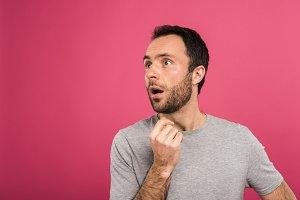 portrait of shocked man looking asid