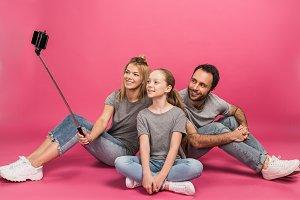 happy family taking selfie on smartp