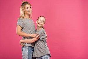 adorable daughter hugging beautiful