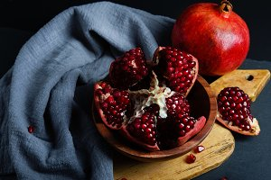 Ripe red intact and cut pomegranates