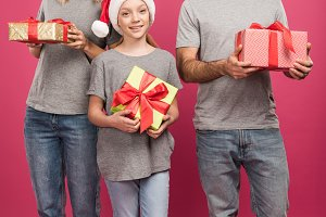 happy family in santa hats holding c