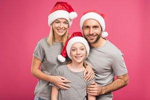 portrait of happy family in santa ha