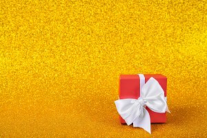 Red gift box in gold background