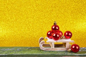 Christmas sled on gold background