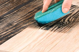 painting wooden board with a sponge
