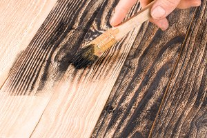 painting wooden board paint brush in