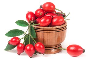 rosehip berries in a wooden bowl