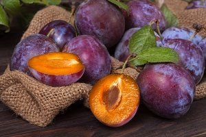 plums on the wooden background with