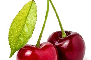 Two cherries with leaf closeup