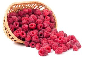 raspberries spilled from a wicker
