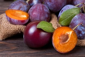 plum on the wooden background with