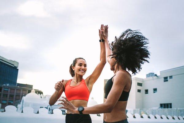 Cheerful fitness women