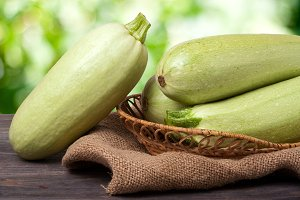 courgettes on the wooden table with